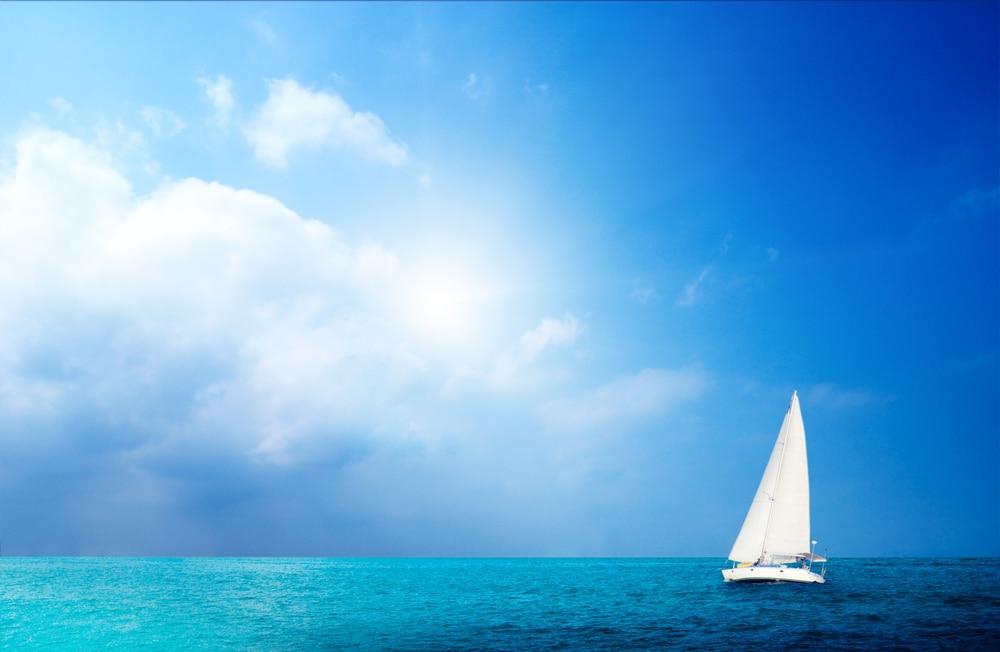 sail boa on blue ocean with blue sky