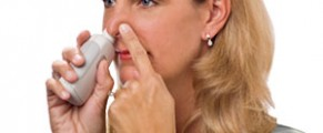 Adult using Ear Popper to relieve ear discomfort when flying
