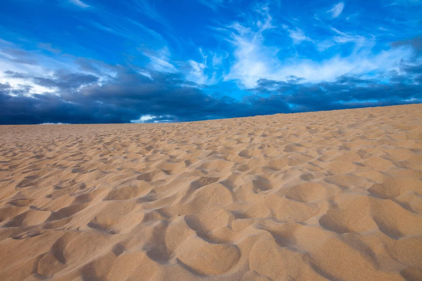 Desert background landscape. Corralejo dunes in Fuerteventura, Canary islands, Spain.