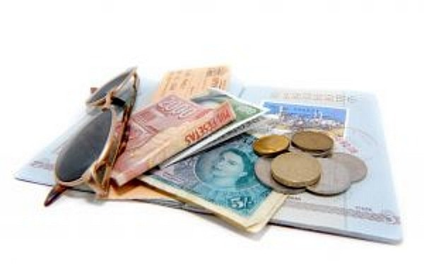 passport, sunglasses and foreign money