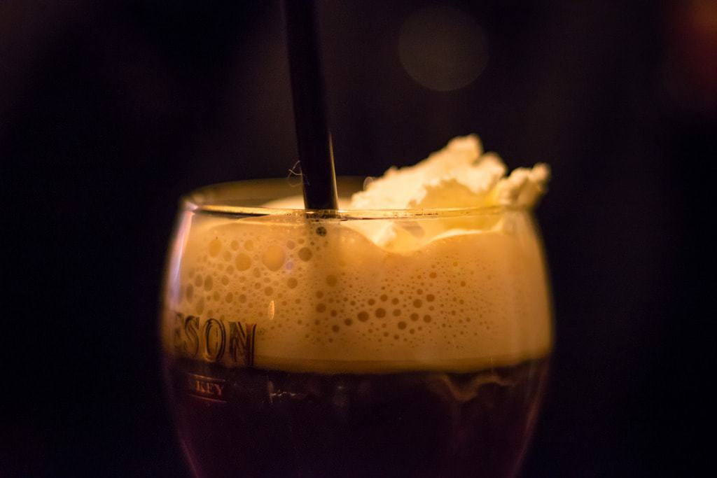 Long before there were all these fancy martini drinks, the Irish Coffee was considered the upscale drink of choice. An Irish Coffee is thought to be a variation of the classic hot toddy and is made with hot coffee, Irish whiskey, and sugar, all stirred together, and is then topped with a thick layer of cream (not whipped cream). You drink the strong liquored coffee through the cream for a smooth flavor.
