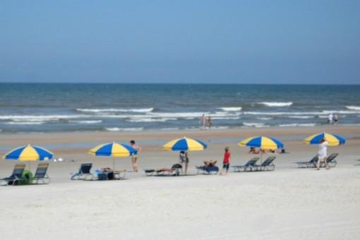 sunbathers on Daytona Beach