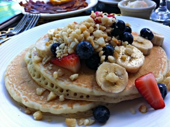 Macadamia nut pancakes with fruit is a delicious Hawaii breakfast