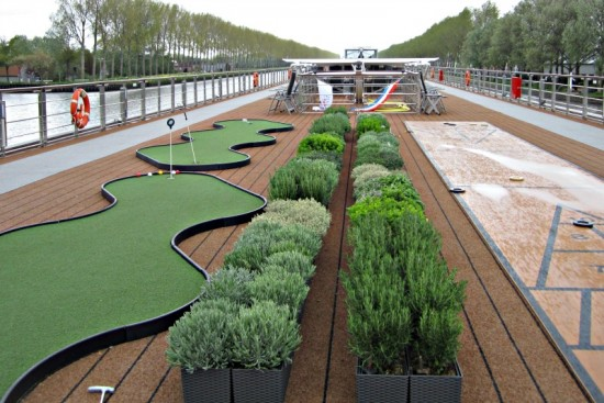 The top deck of the Viking Eistla has shuffleboard, a putting green, and a herb garden