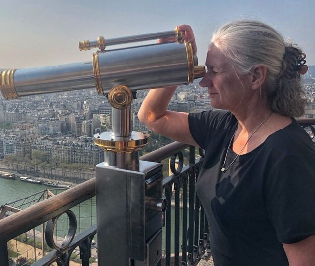 wearing travelsmith clothes while on the summit of the eiffel tower in paris