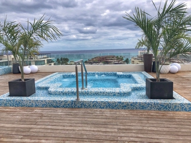Soak in a hot tub with a view of the ocean at Reef 28 in Playa del Carmen Mexico.