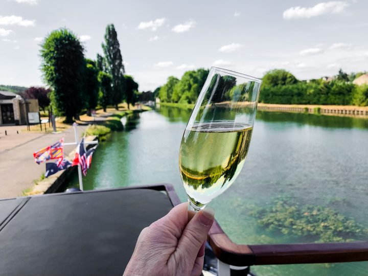 A champagne toast, one of many, onboard our European Waterways luxury barge cruise.