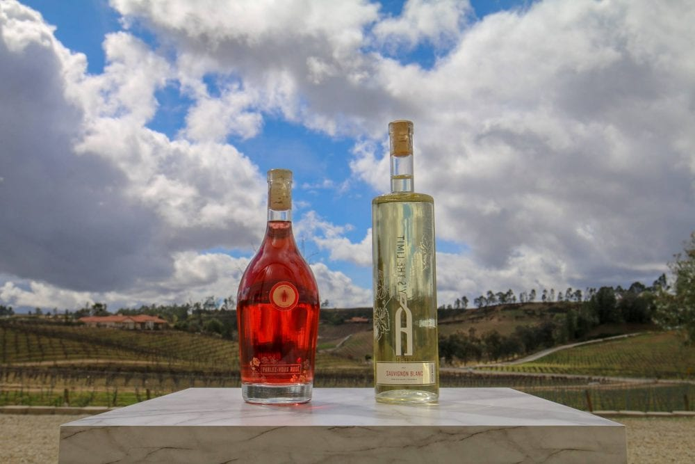 Beautiful bottles of Akash wine look out at their vineyards.