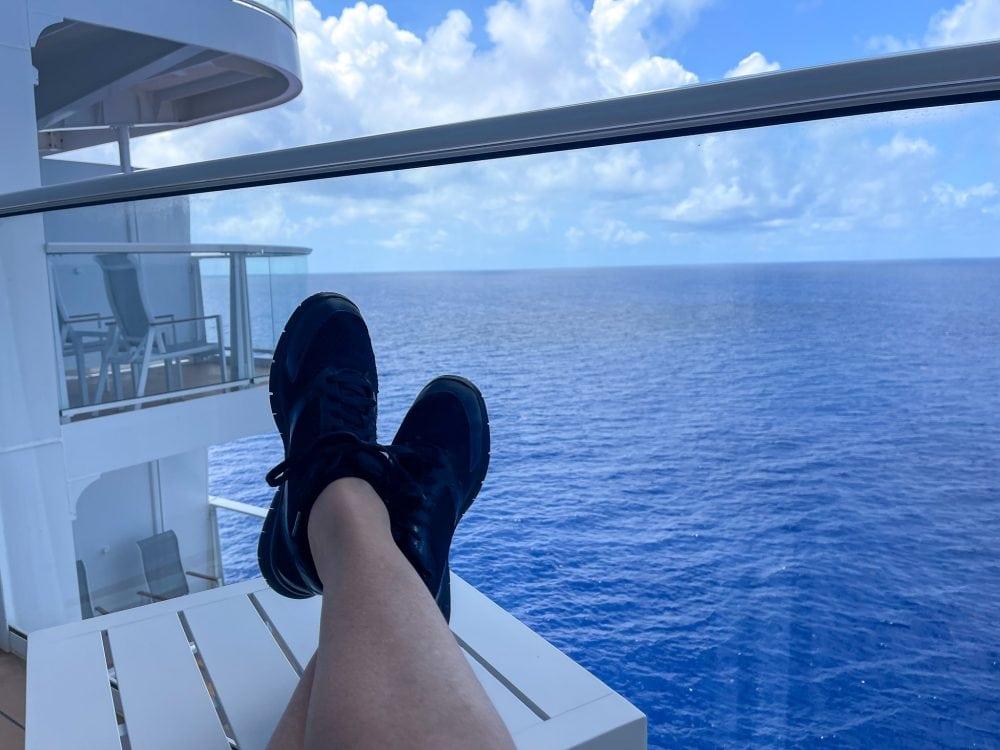feet up on a cruise ship balcony
