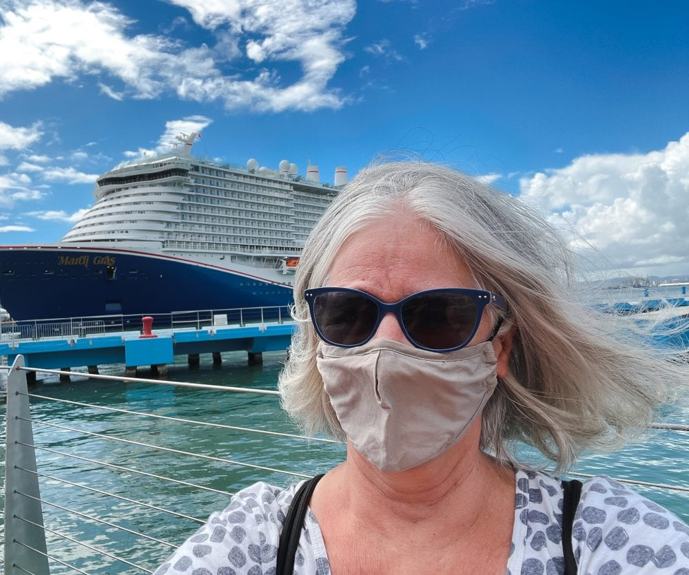 Mary Jo standing in front of the new Mardi Gras from Carnival Cruise Lines